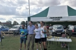 Dr Dan Poulter presenting the first Male Team prize to the Framlingham Flyers Team, (from left to right) Jim Last,  Andrew Rooke (overall race Winner!) and Adam Howlett.