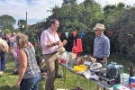 Dr Dan Poulter with visitors to Westerfield Fete